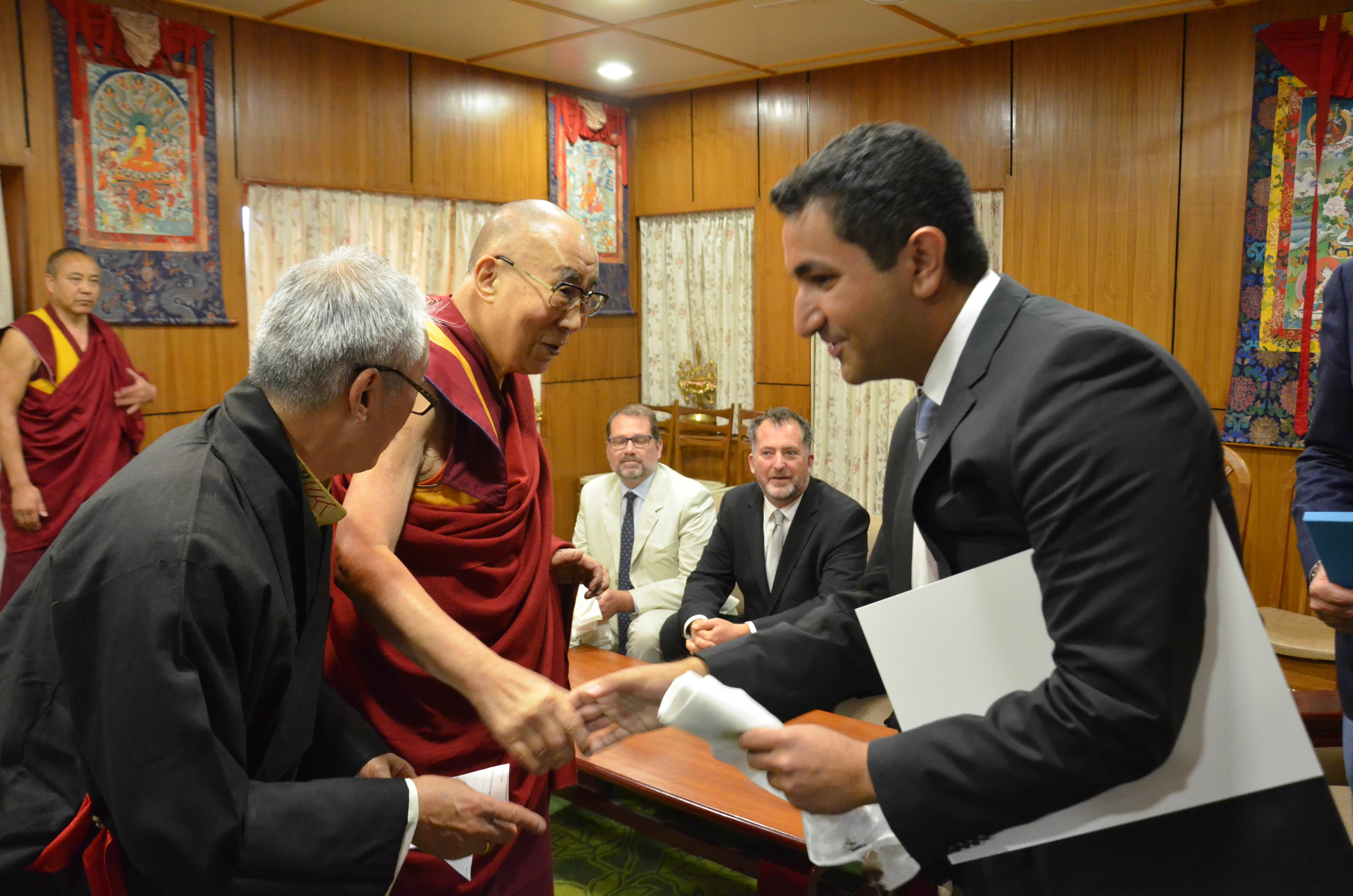 Habib shaking HHDL hands
